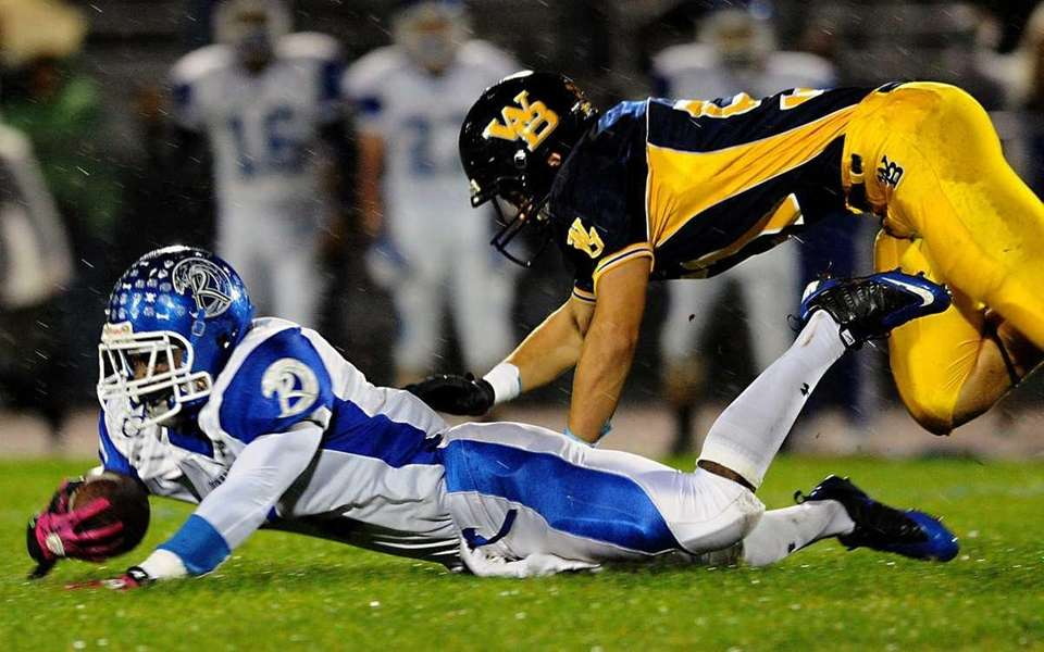 Riverhead High School #7 Reginald Moore, left, dives