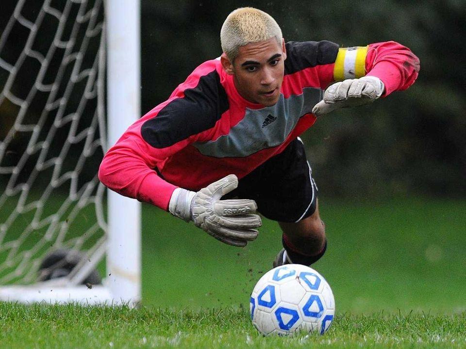 Commack High School goalkeeper Jake Amereno dives to