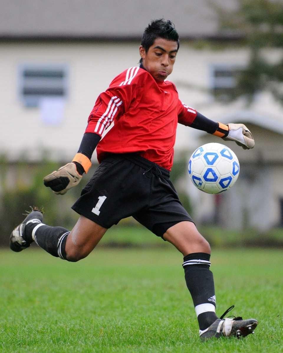 Brentwood High School goalkeeper Raul Bonilla kicks a