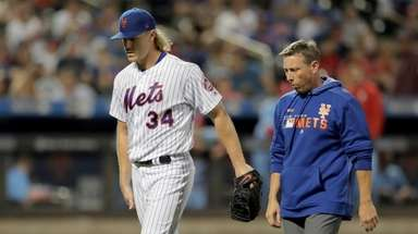 Mets starting pitcher Noah Syndergaard limps off with