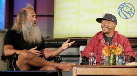 Rick Rubin, left, and Russell Simmons speak at