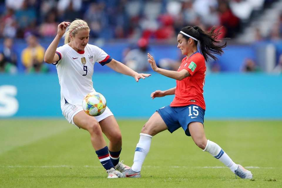 Lindsey Horan of the USA is challenged by