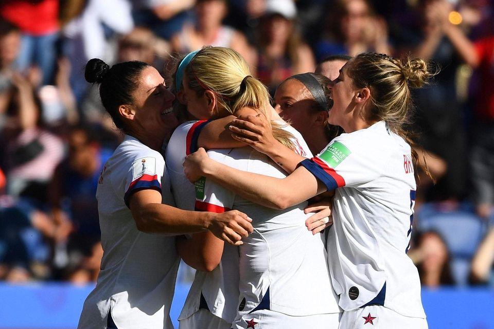 United States' midfielder Julie Ertz (C) is congratulated