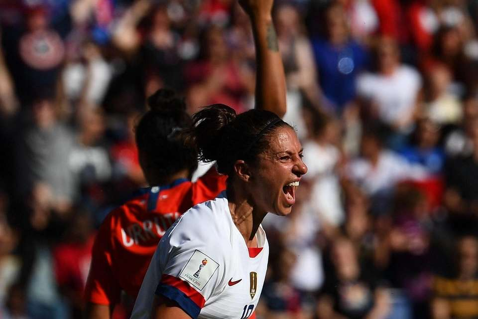 United States' forward Carli Lloyd celebrates after scoring
