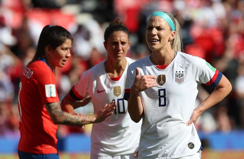 USA's Julie Ertz (R) reacts during the Group