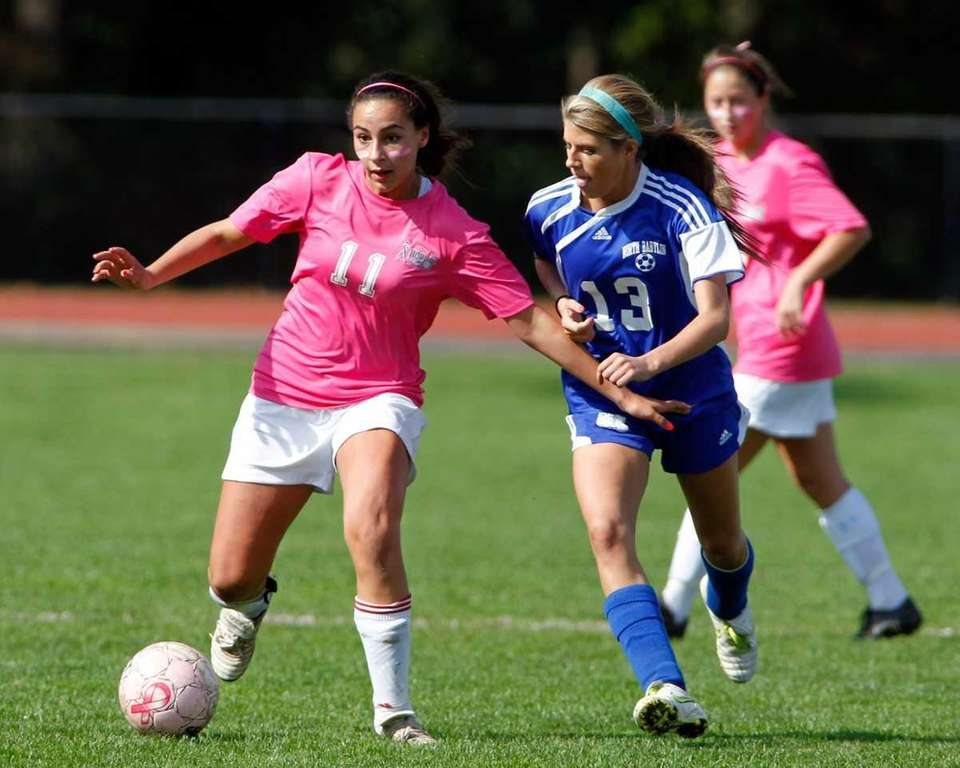 Hauppauge's Juliette Loccisano #11 is defended by North