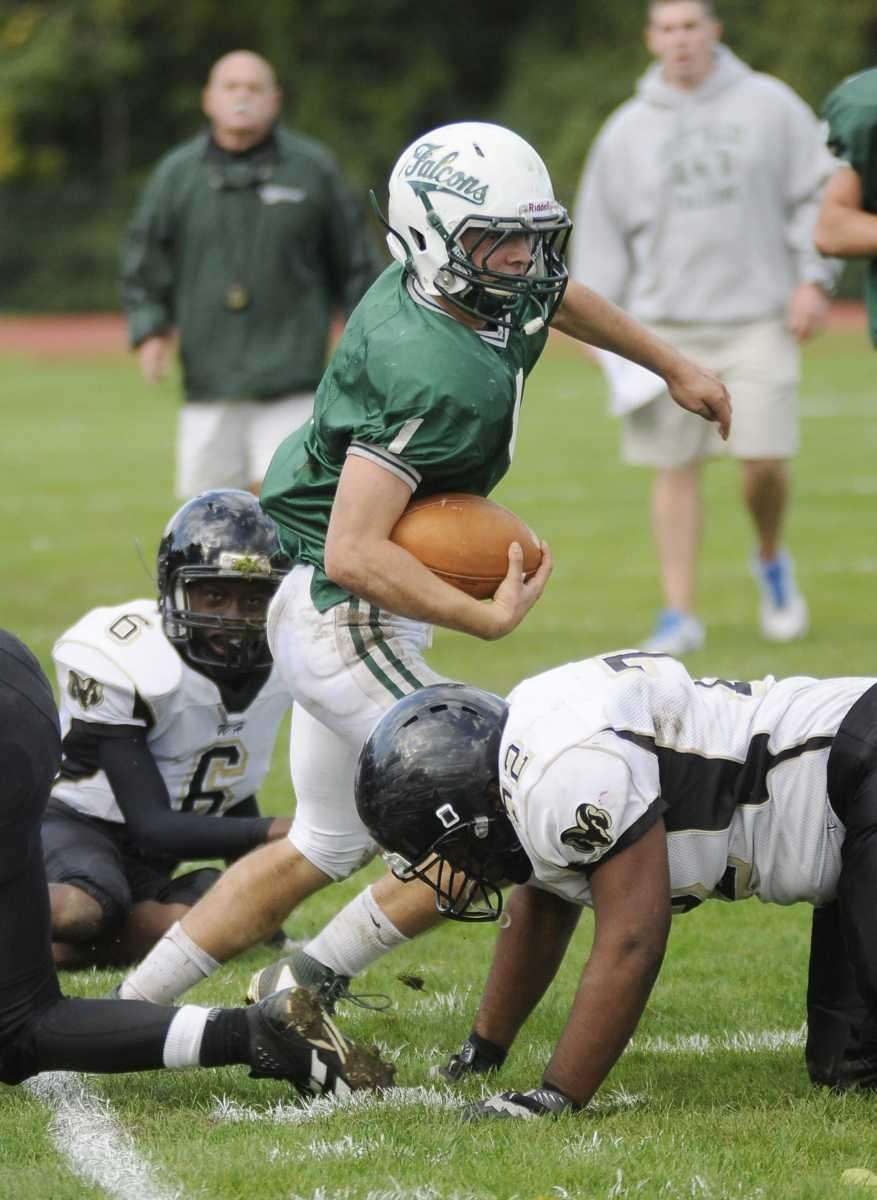 Locust Valley's (green jersey) #1 Chris Appell fakes