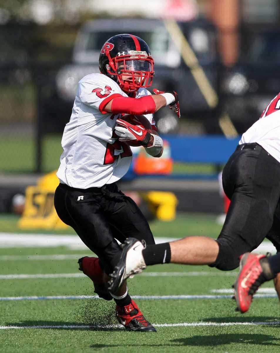 Plainedge #21 Ralph Caccavale runs for extra yards.