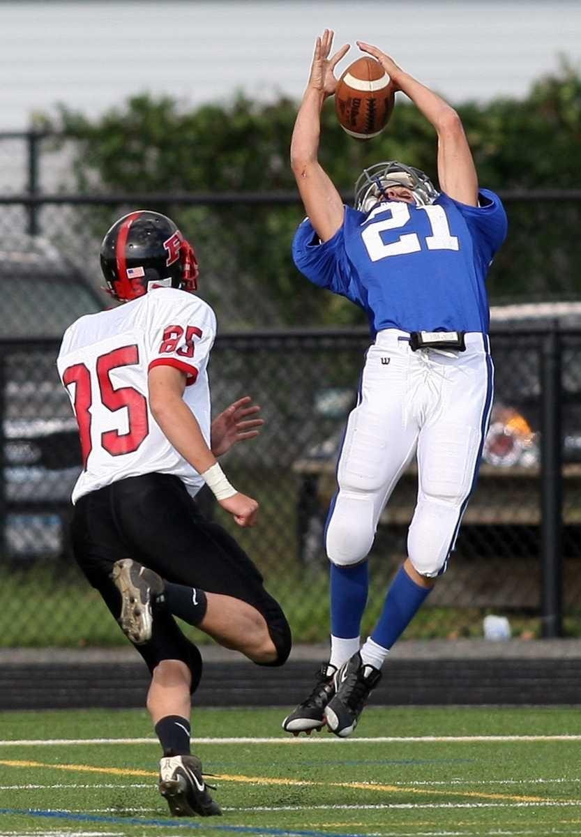 Division's #21 Jon Maldonado lets the ball go