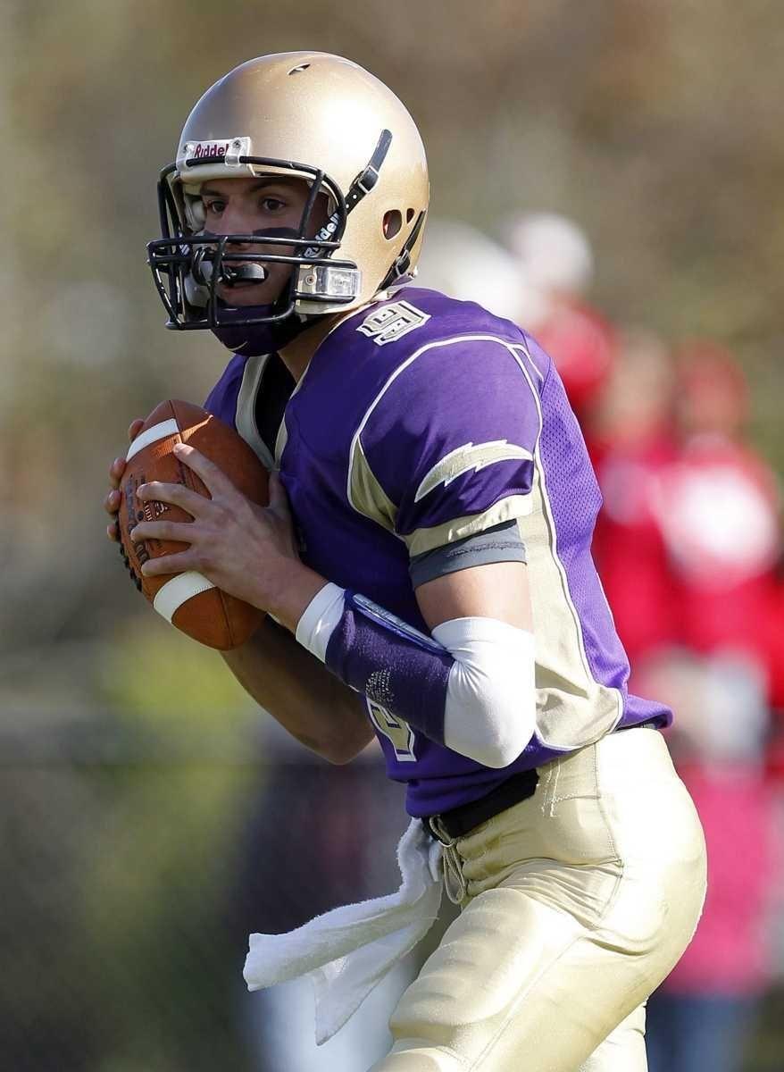 Sayville quarterback Steven Ferreira (9) steps into the