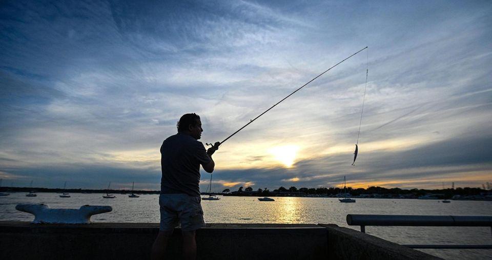 Claudio Vasquez of Port Washington tries his fishing