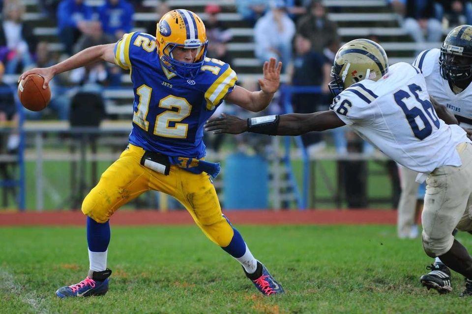 East Meadow High School quarterback #12 Dylan Curry,