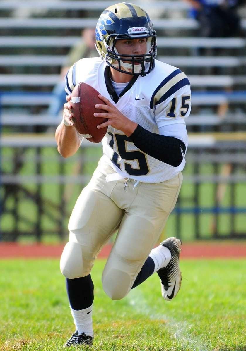 Baldwin High School quarterback #15 Patrick Dillon rolls