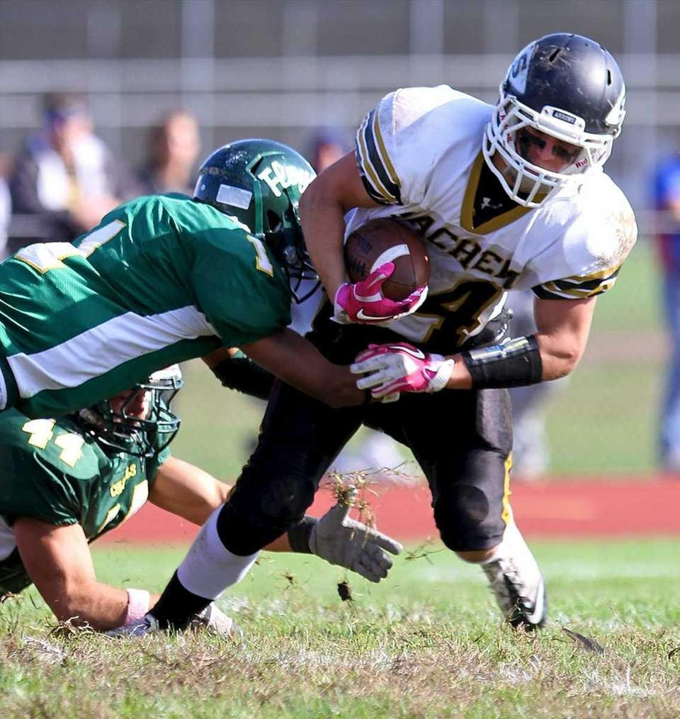 Sachem North RB Dalton Crossan #34, is stopped