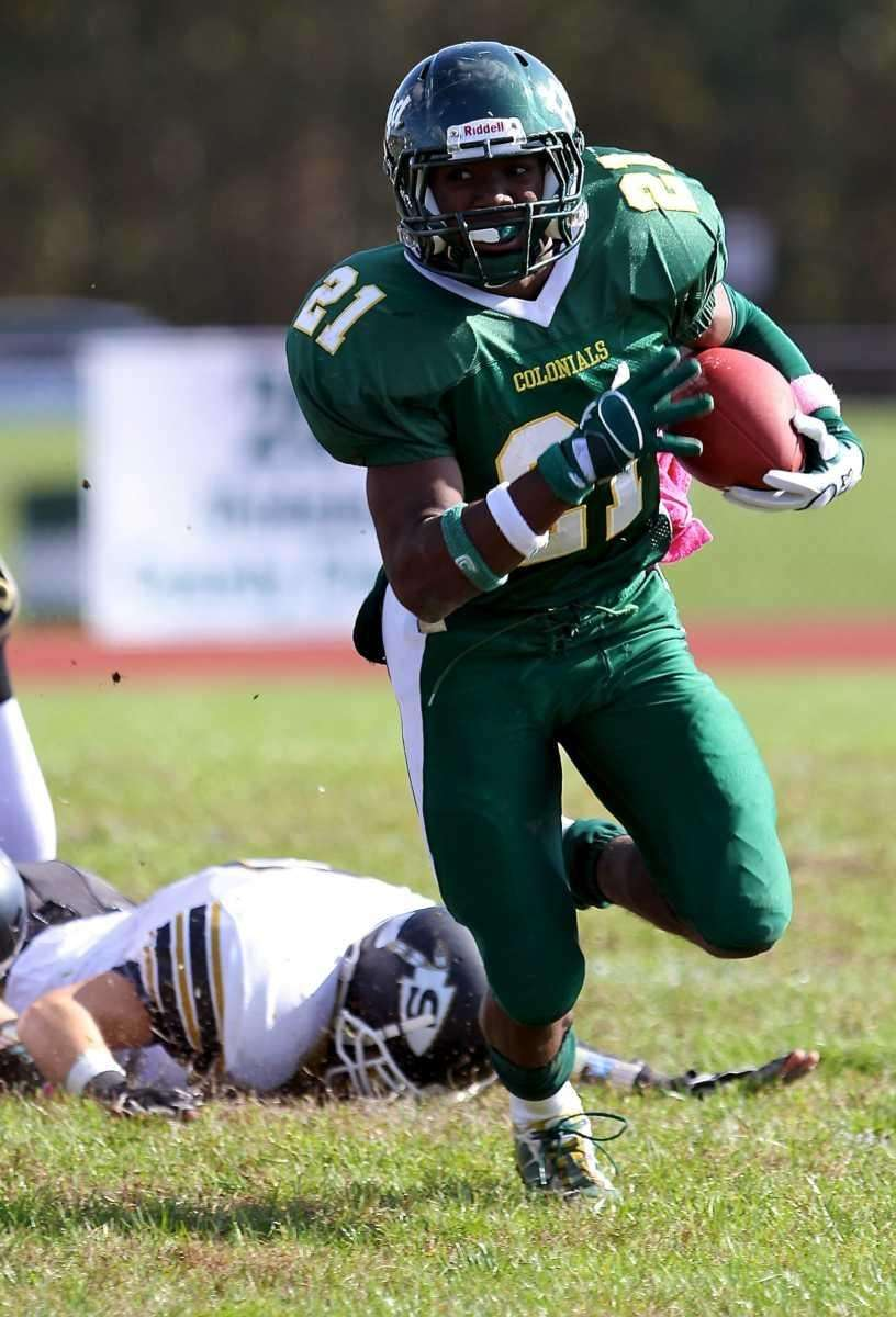 William Floyd RB Stacey Bedell #21, turns upfield
