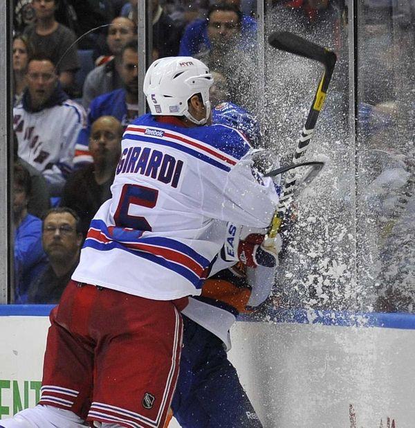Dan Girardi of the Rangers smashes Matt Moulson