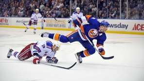 John Tavares of the Islanders flies over Marian