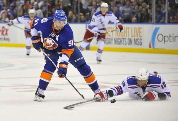 Marian Gaborik of the Rangers tries to knock