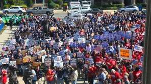 Union members demonstrate in front of the Nassau