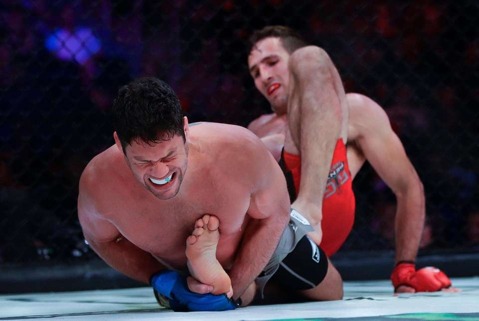 Neiman Gracie, left, grimaces during the second round