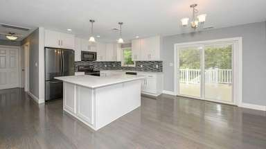 This newly renovated Mastic home is listed for