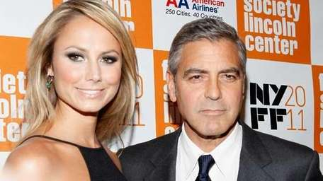 Stacy Keibler and actor George Clooney attend New