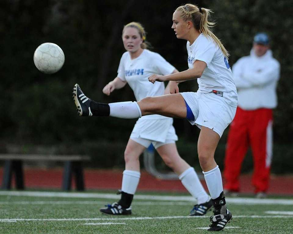 Kellenberg's Erica Berry kicks a ball upfield in