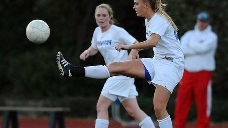 Kellenberg's Erica Berry kicks a ball upfield in