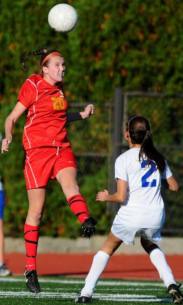 Sacred Heart's Cassidy Prior, left, heads a ball