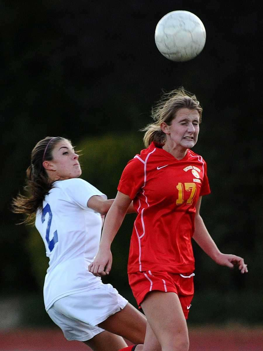 Sacred Heart's Emily Parush, right, heads a ball