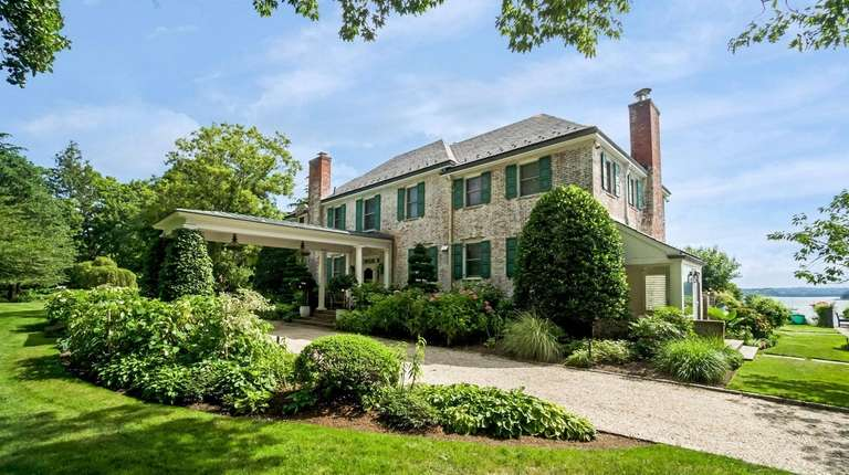 This Centre Island six-bedroom brick main house was