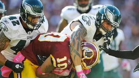 Jabar Gaffney of the Washington Redskins is tackled