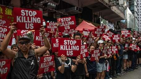 Protesters demonstrate against the now-suspended extradition bill on