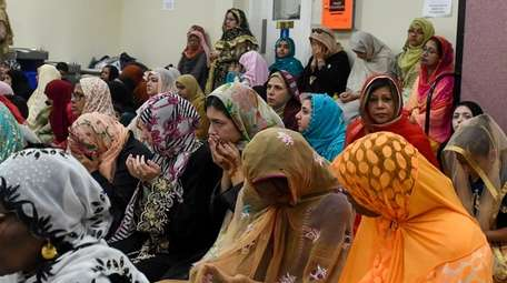Women pray at the Selden Mosque on the
