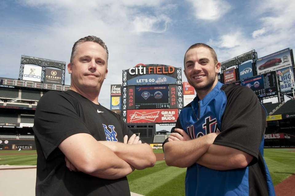 David Wright of the Mets, right, poses for