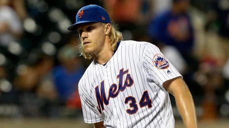 Noah Syndergaard #34 of the Mets stands on