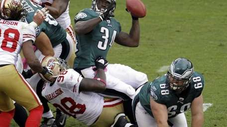Philadelphia Eagles running back Ronnie Brown fumbles the