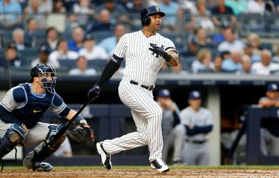 Aaron Hicks of the Yankees follows through on