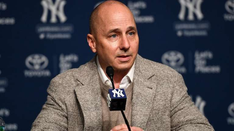 Brian Cashman speaks to the media during a