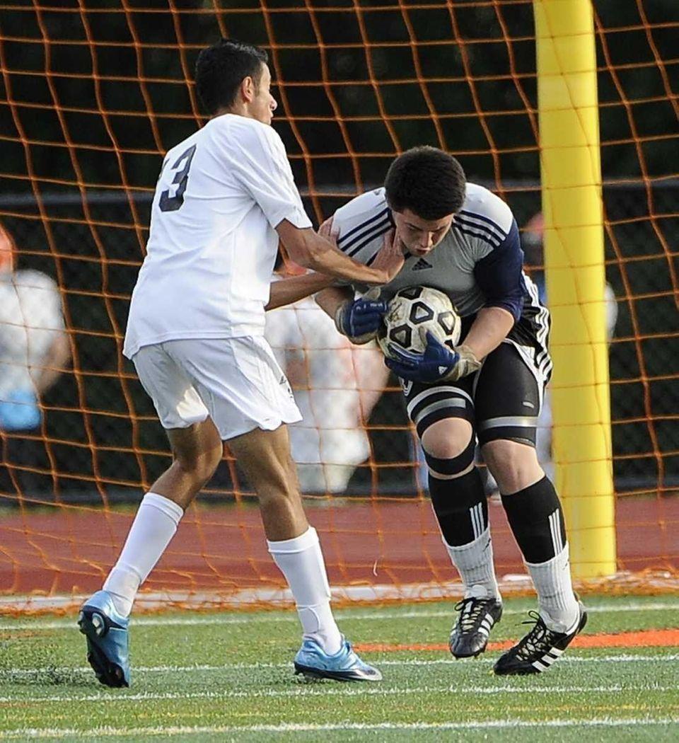 Uniondale goal keeper Brandon Pena saves a shot
