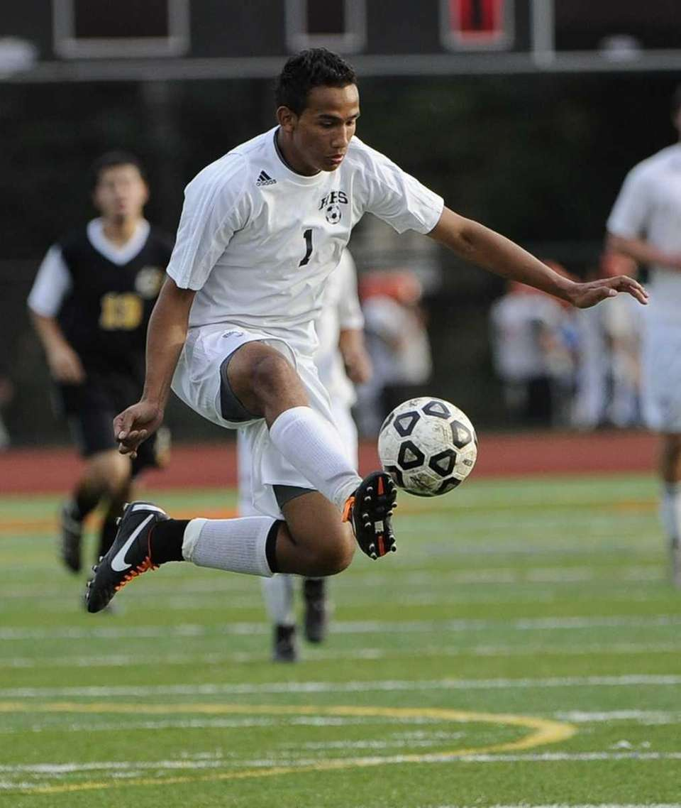 Hicksville's Marcos Bonilla traps the ball in the