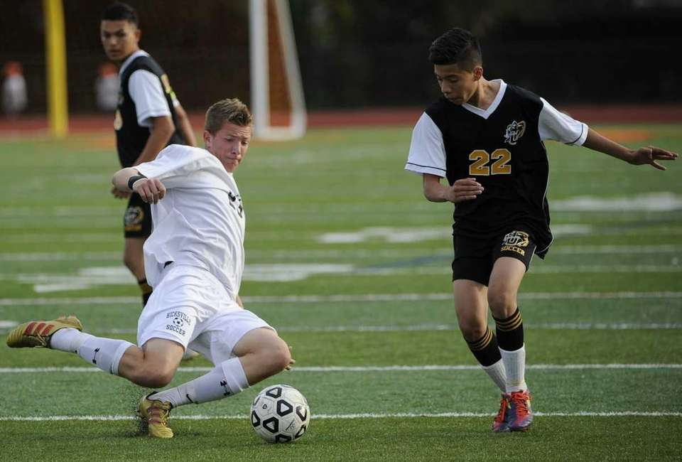 Hicksville's Peter DiLorenzo defends the ball with a
