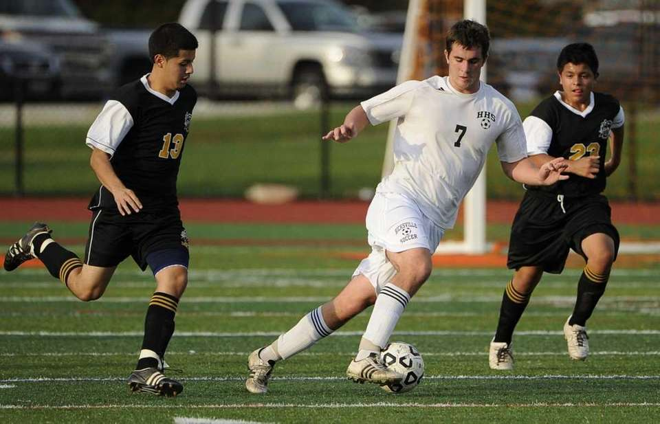 Hicksville's James Myers controls the ball between Uniondale