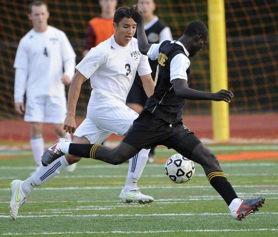 Uniondale's Nyder Chardonette, right, defends against Hicksville's Kyle
