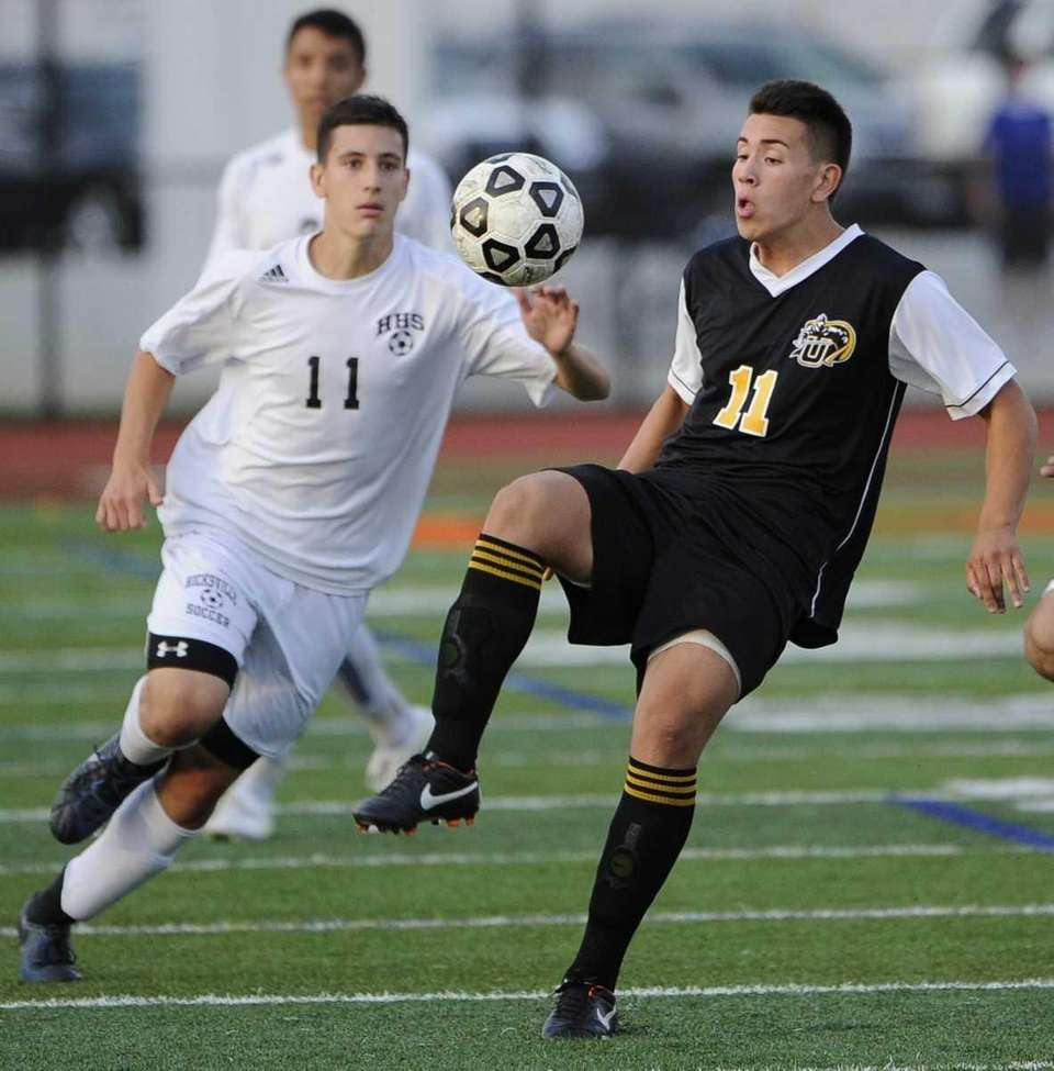 Uniondale's Frankie Villegas, right, juggles the ball in