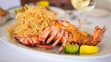 A two-pound, perfectly steamed lobster is accompanied by