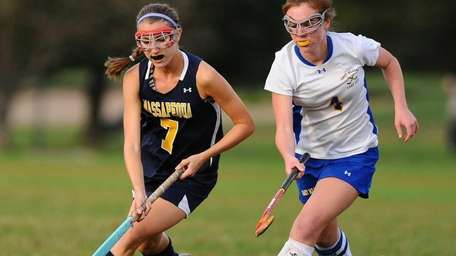 Massapequa High School forward #7 Kristin Yevoli, left,