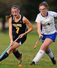 Massapequa High School forward #7 Kristin Yevoli, left,
