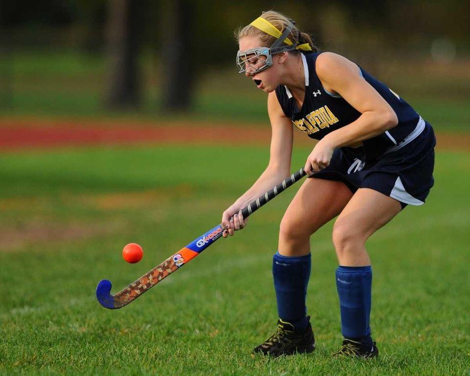 Massapequa High School defender #13 Dana Ahrens looks