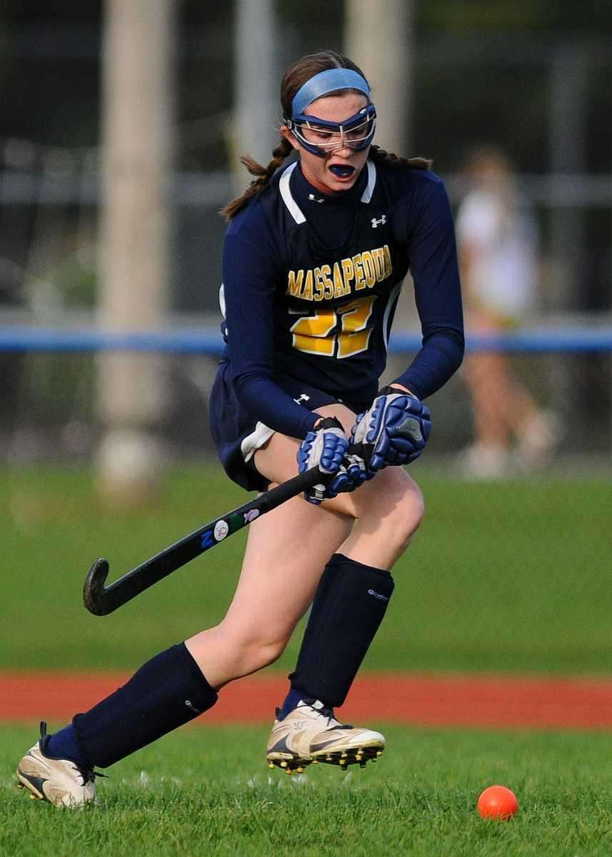 Massapequa High School forward #22 Kelsey O'Brien chases
